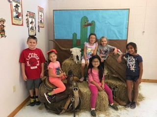 LP Elementary PK-6th Grade students demonstrate Perfect Attendance for the 5th Six Weeks were treated with a western theme photo and treat in the school library.