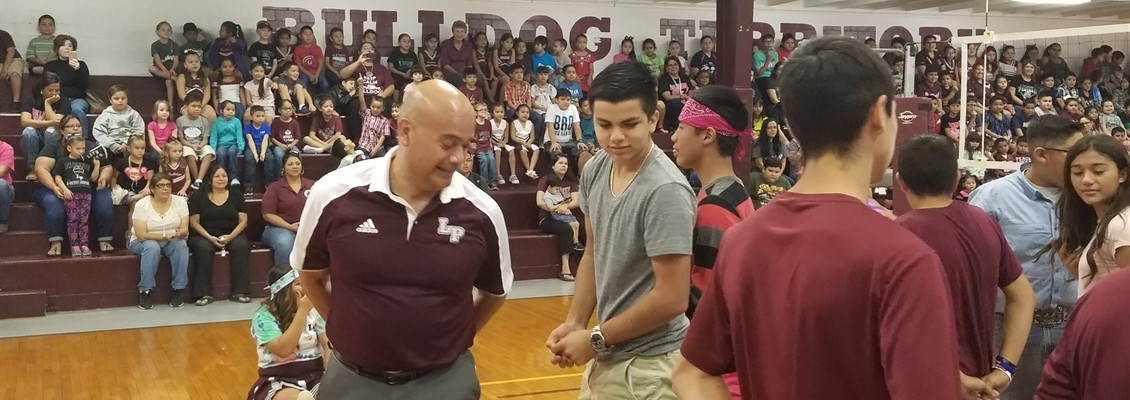 Mr. Dominguez competing hard at the Pep-Rally!