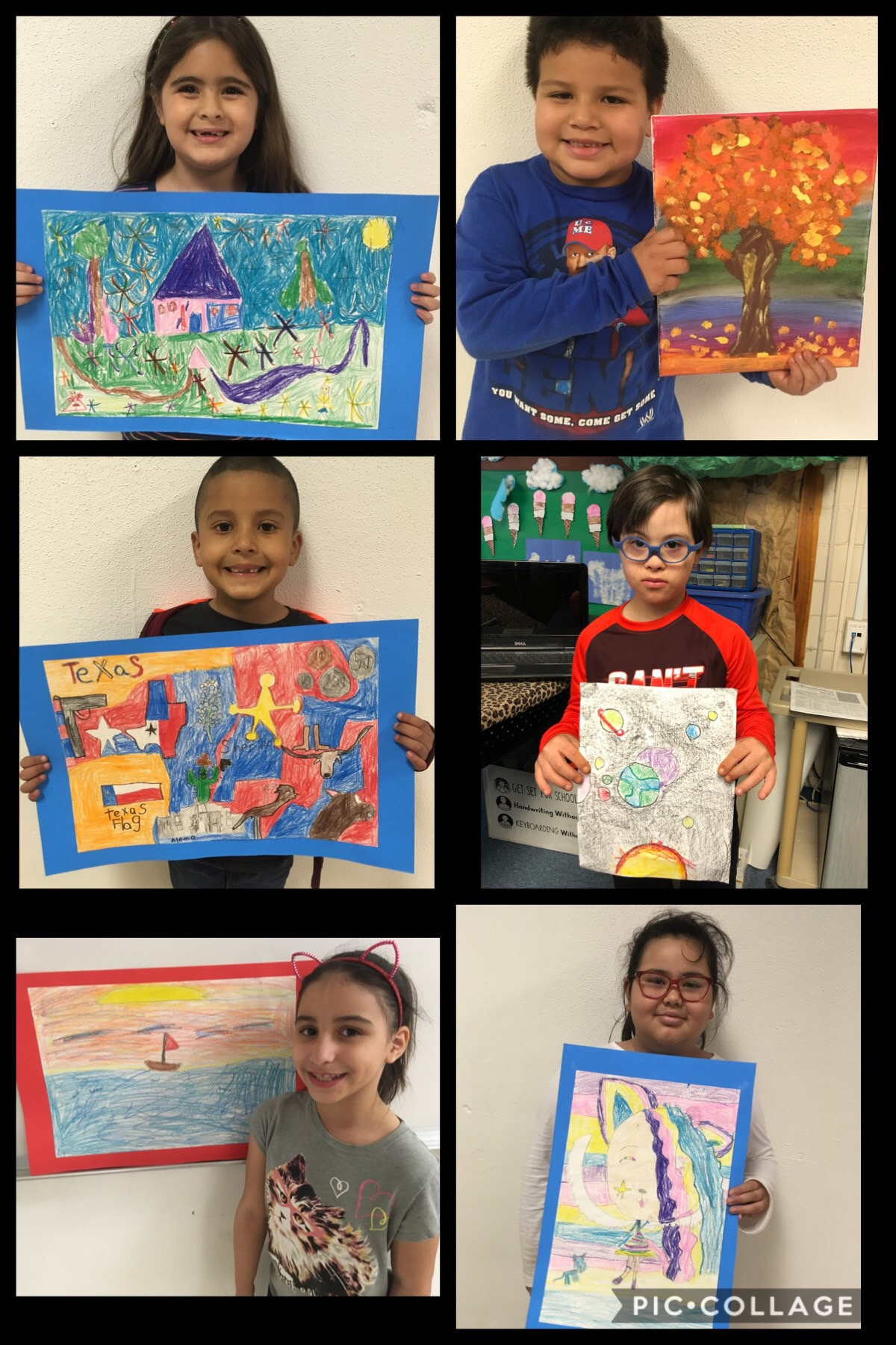 ELEMENTARY STUDENTS SHOWING THEIR PAINTINGS AND DRAWINGS.